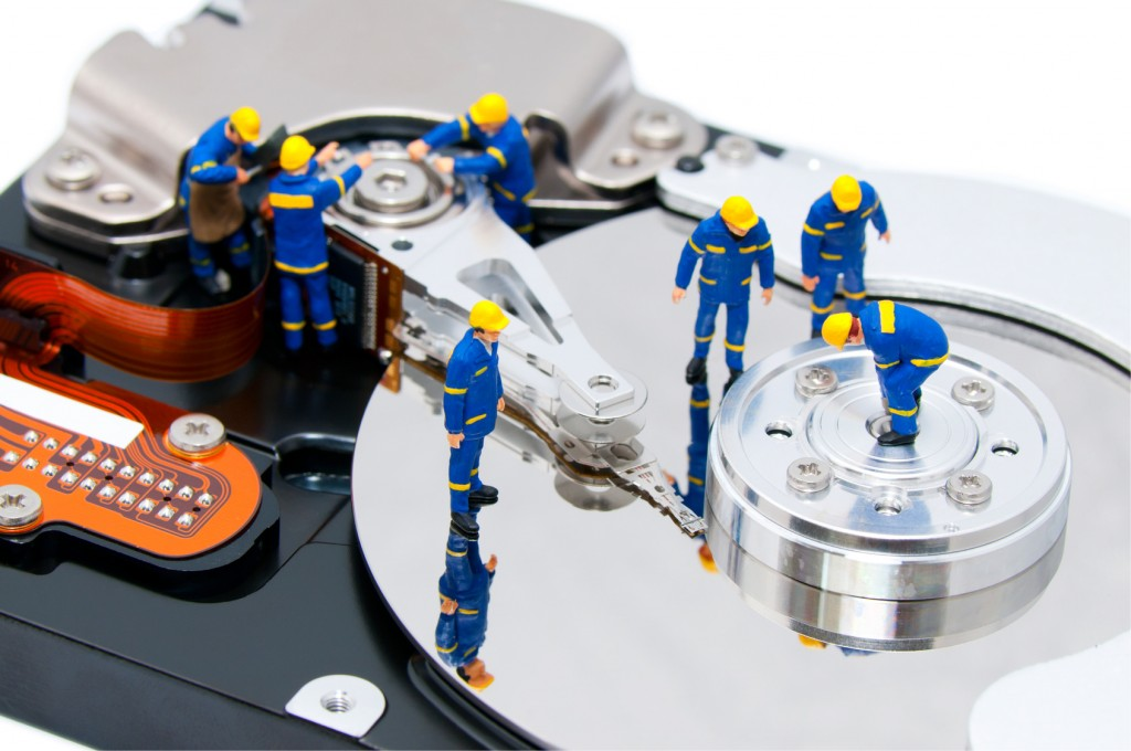 Group of technicians repair hard drive